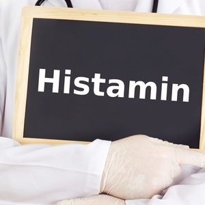 Doctor shows information on blackboard: histamine